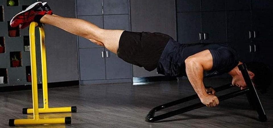a man using a dip bar to exercise