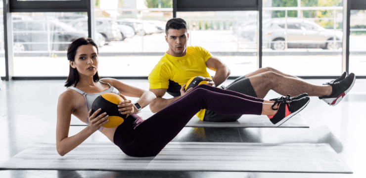 a woman and a man exercising together