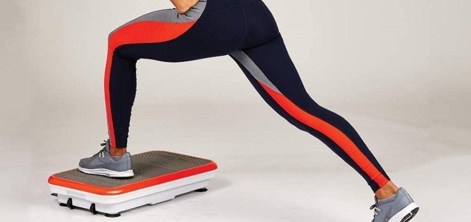 a woman exercising on a vibrating platform machine