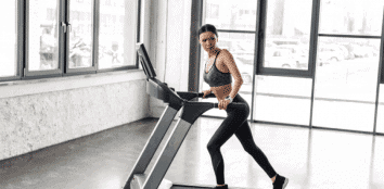 a woman exercising on treadmill featured image