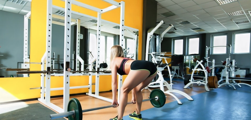 a woman exercising with a power range