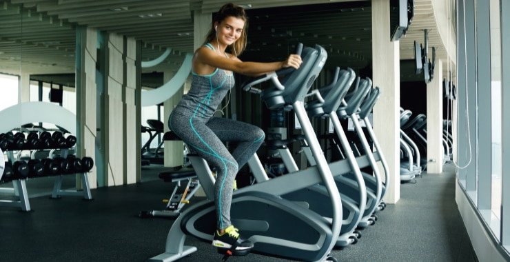 a woman exercising with an exercise bike