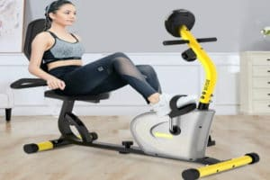 A woman exercising on her recumbent exercise bike