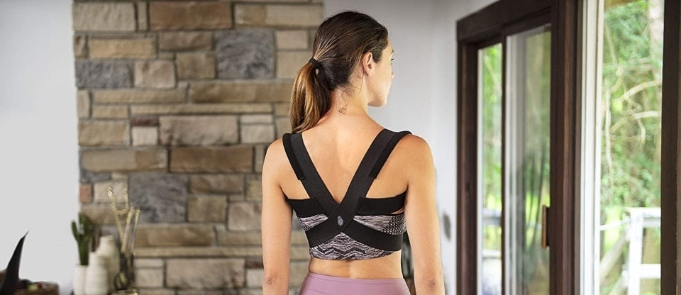 a woman is using a posture correctors