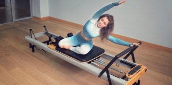 A woman stretching on her pilates reformer