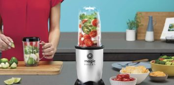 a woman using a blender on her kitchen table