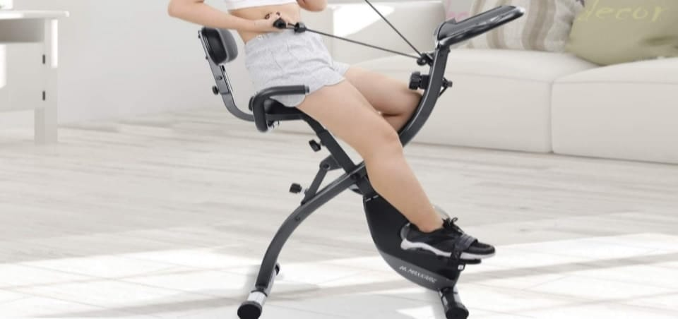 a woman using her folding exercise bike