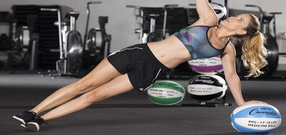 a woman using her medicine ball to exercise