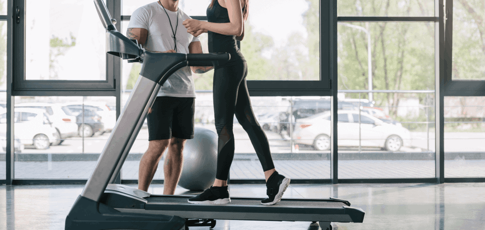 a woman walking on the treadmill banner image