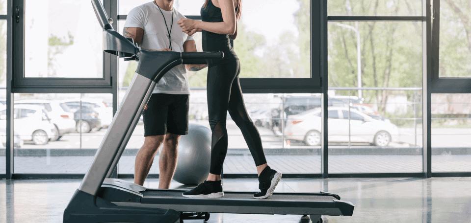 a woman walking on the treadmill