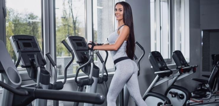 a women using an elliptical machine