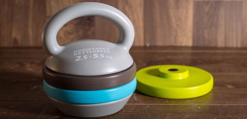 an adjustable kettlebell on a wooden table