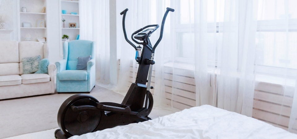 an elliptical trainer stands in the living room