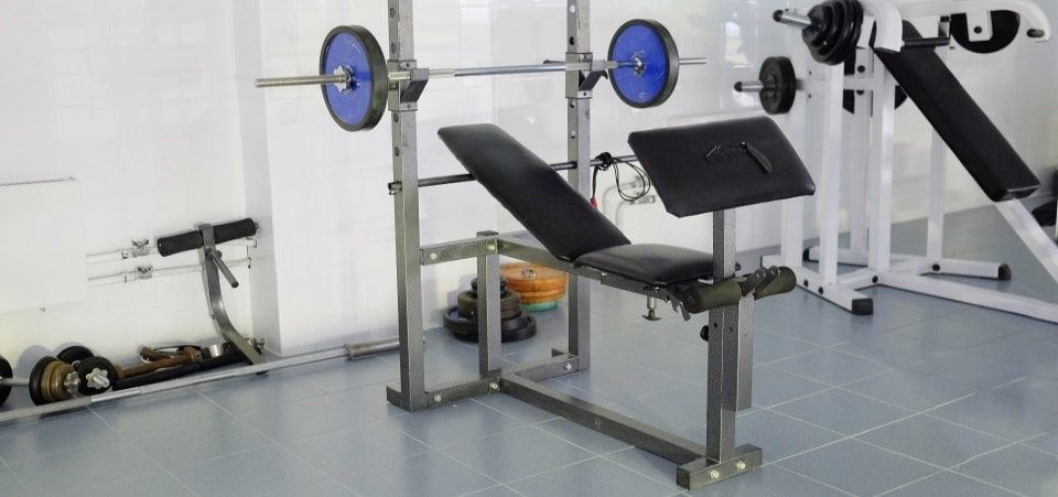 an olympic weight bench near training apparatus