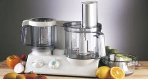 food blender with fruit and vegetable around