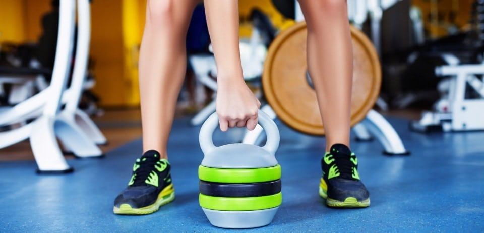 girl with kettlebell in gym
