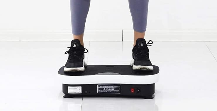 image shows a person using a vibrating machine