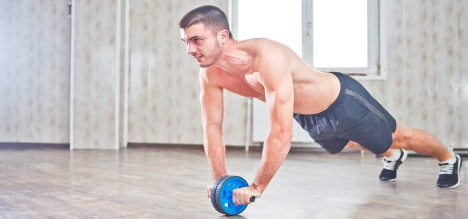 image shows a person using an ab roller