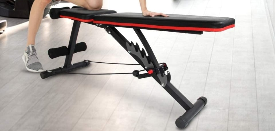 image shows a woman's knee on a folding weight bench