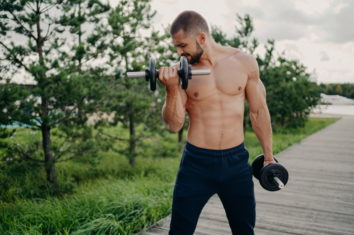 man exercising with adjustable dumbbells
