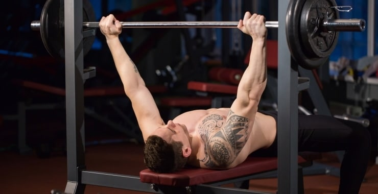 man building chest muscles with the bench press