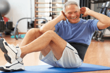 older man wearing a waist trimmer while exercising