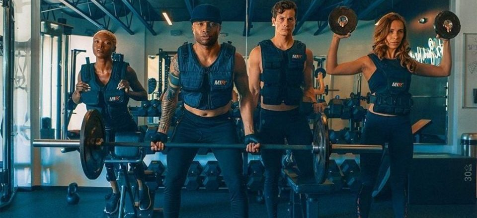 people doing exercises dressed in weighted vests