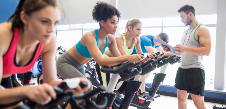 personal trainer watches a group of girls working out