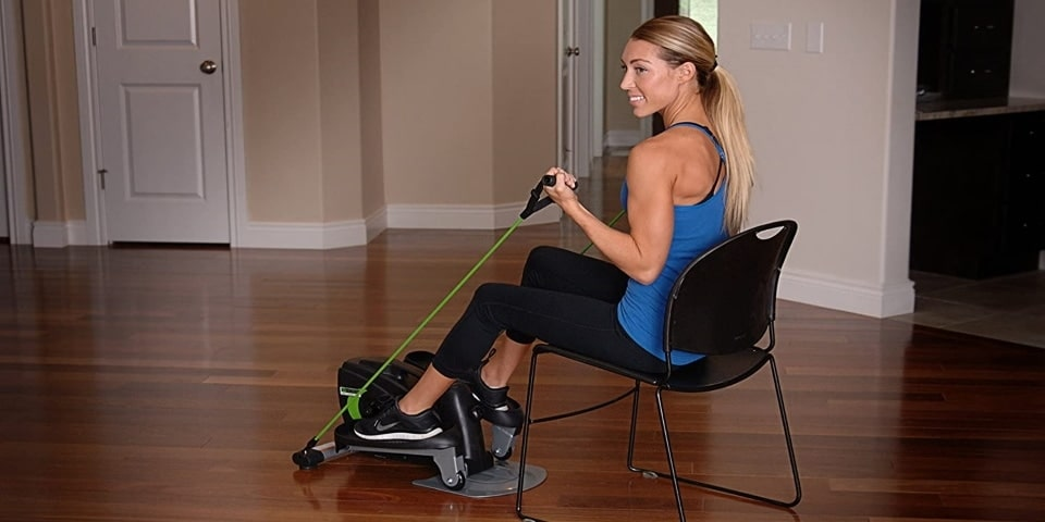 the woman is exercising while sitting on a chair