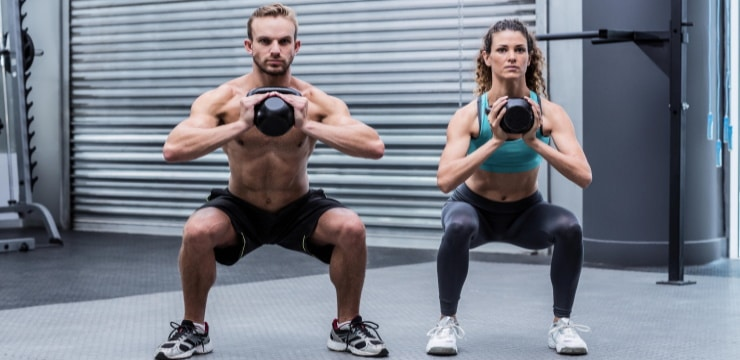 two people exercising with kettlebells