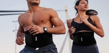 two people running while wearing waist trimmer belts