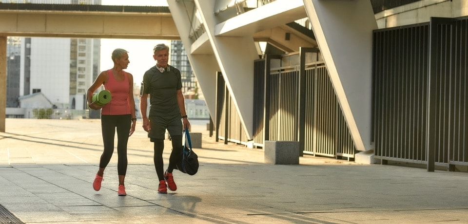 two people walking together after the gym