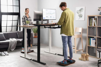 two people working on their computers on balance tables