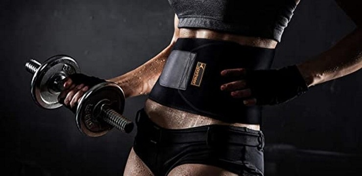 woman wearing a waist trimmer while working out with dumbbells