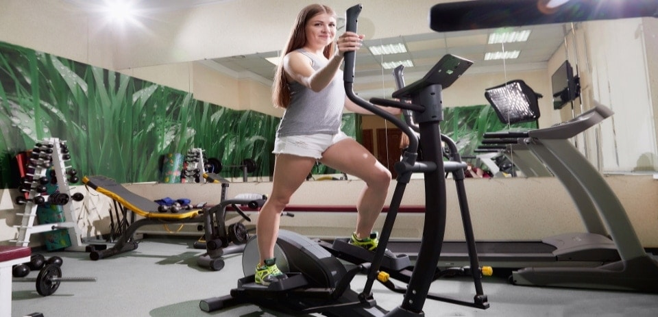 young woman exercising in an elliptical